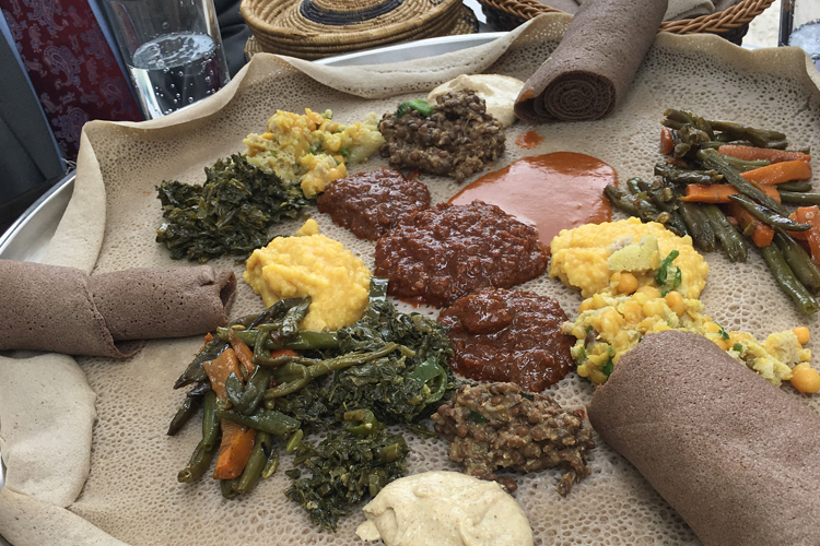 From President Gertler's Instagram account: photograph of a traditional Ethiopian lunch