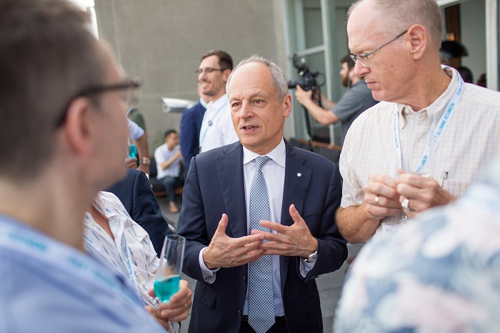 President Meric Gertler chatting with alumni at the LGBTQ+ Spring Soirée. Photo by Paul Terefenko.