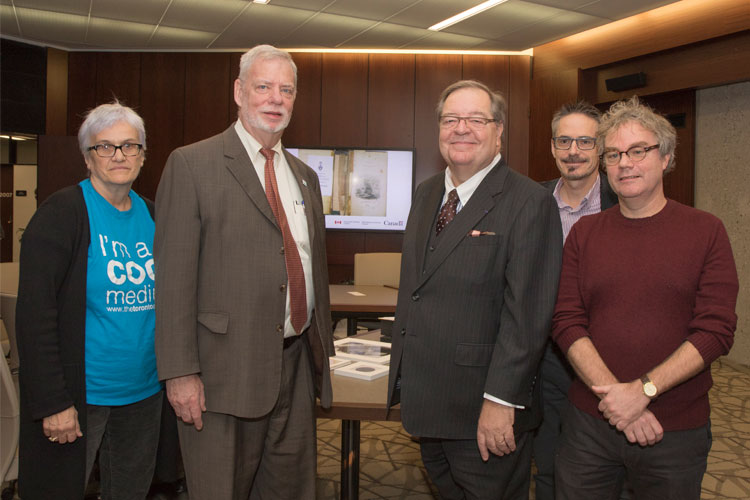 From left: Wendy Duff, dean of U of T's Faculty of Information, Larry Alford, Guy Berthiaume, Robert Fisher of Library and Archives Canada, and John Shoesmith, U of T librarian, at the UNESCO announcement event. Photo by Romi Levine.