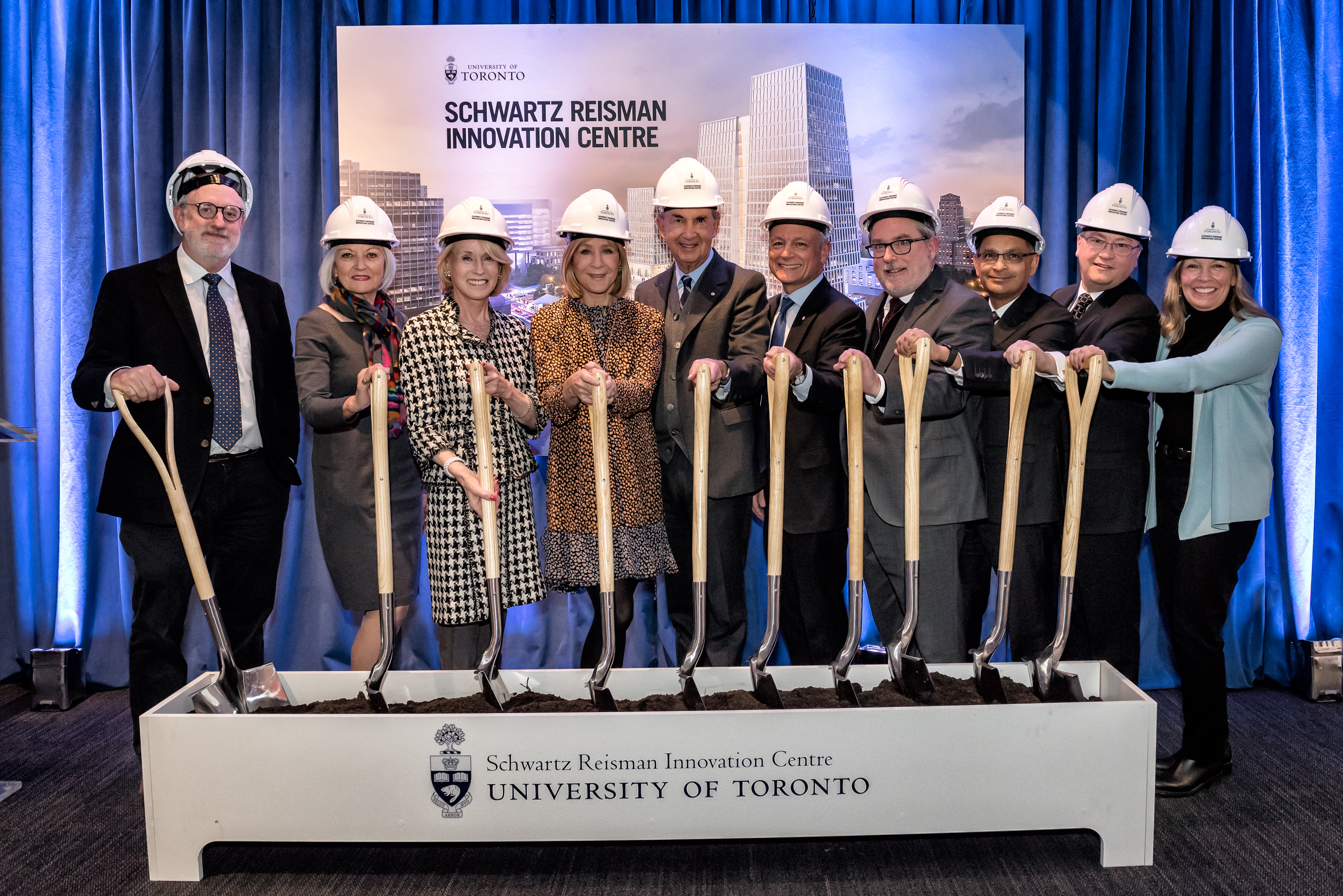 President Meric Gertler, Heather Reisman, Gerald Schwartz and others hold shovels at groundbreaking ceremony