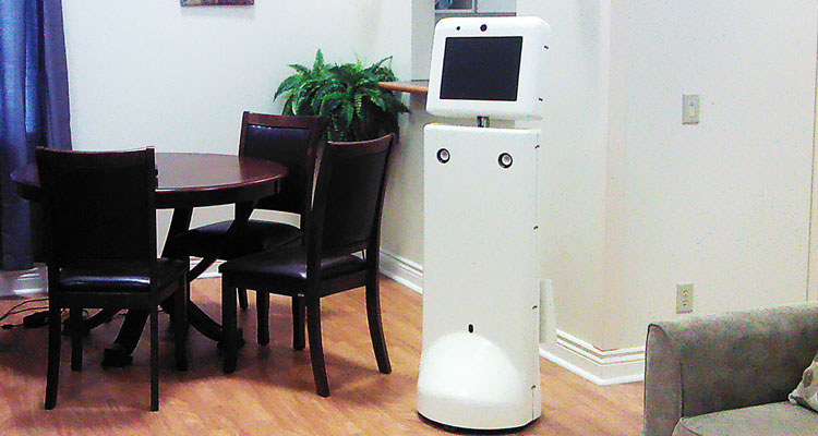 Ed the robot is a four-foot tall plastic column with a screen attached to the top like a head.