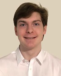 Portrait of Jacob Kolyakov smiling.