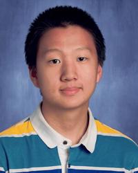 Portrait of Kevin Qu smiling.