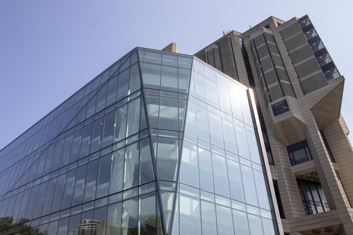 A four-storey building, completely walled in glass, projects from the side of Robarts Library.