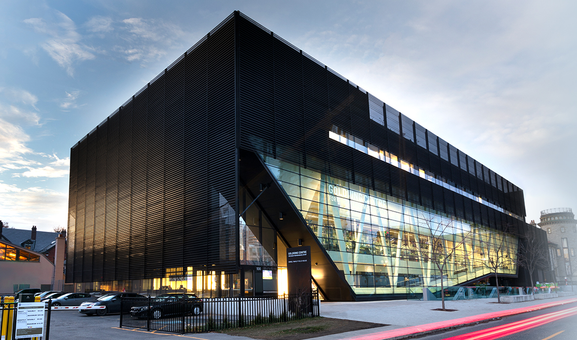 The Goldring Centre for High Performance Sport viewed from the southeast, at dusk.