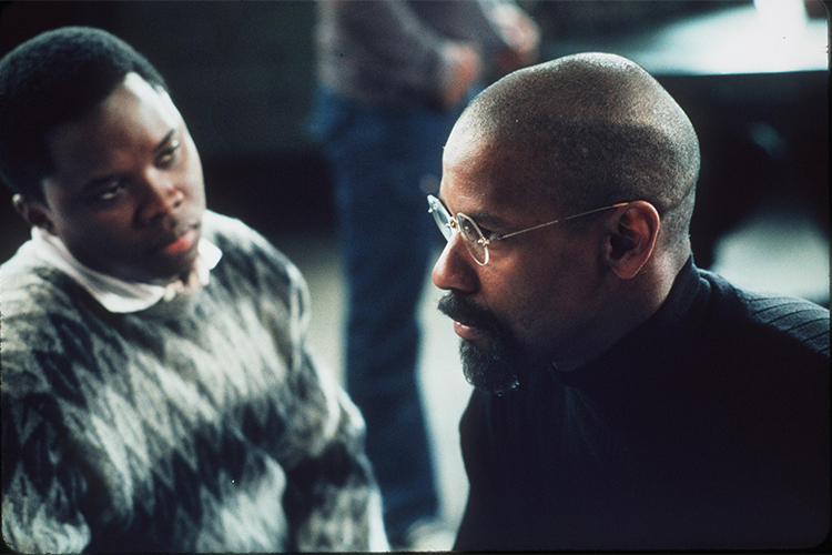 Vicellous Reon Shannon, playing Lesra Martin, looks doubtfully at Denzel Washington in a scene from The Hurricane.