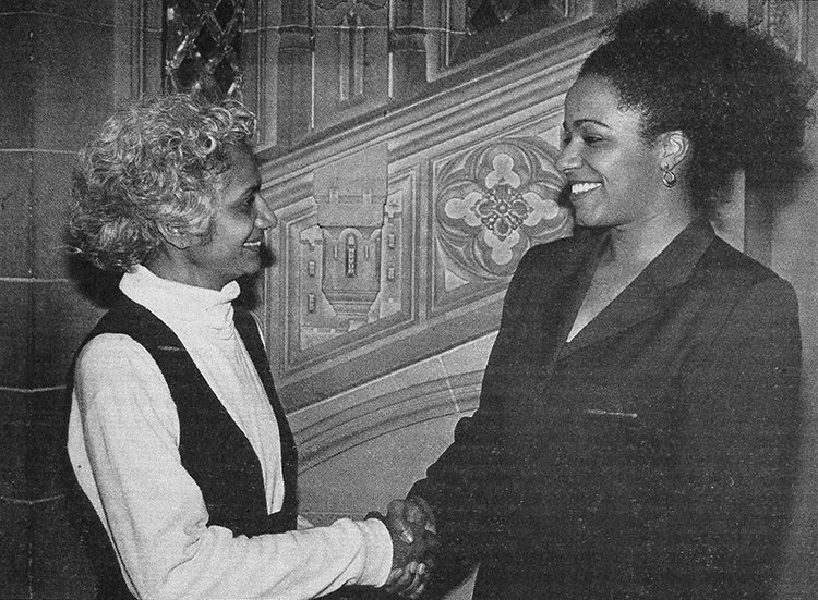 Ceta Ramkhalawansingh and Stefanie Samuels shake hands and smile in this old photograph.